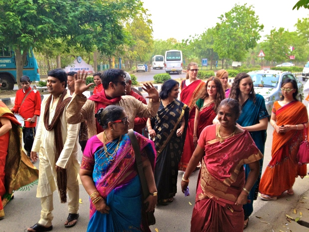 Dancing on the street prior to a wedding ceremony in Delhi.